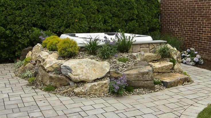 """Spas Help Make Picturesque Backyards - Hot Tub Installation: Bringing in boulders, soil and plants can create a """"set in garden"""" look that adds charm and beauty to the backyard.   More: http://www.longislandhottub.com/longisland_hot_tub_spa_blog/?p=1437"""