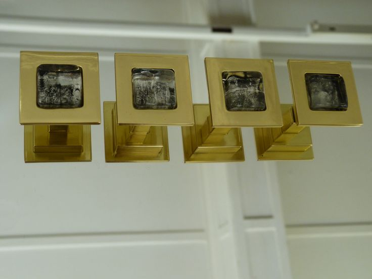 Cabinet handles in polished brass and glass insert. Made for Harrods.
