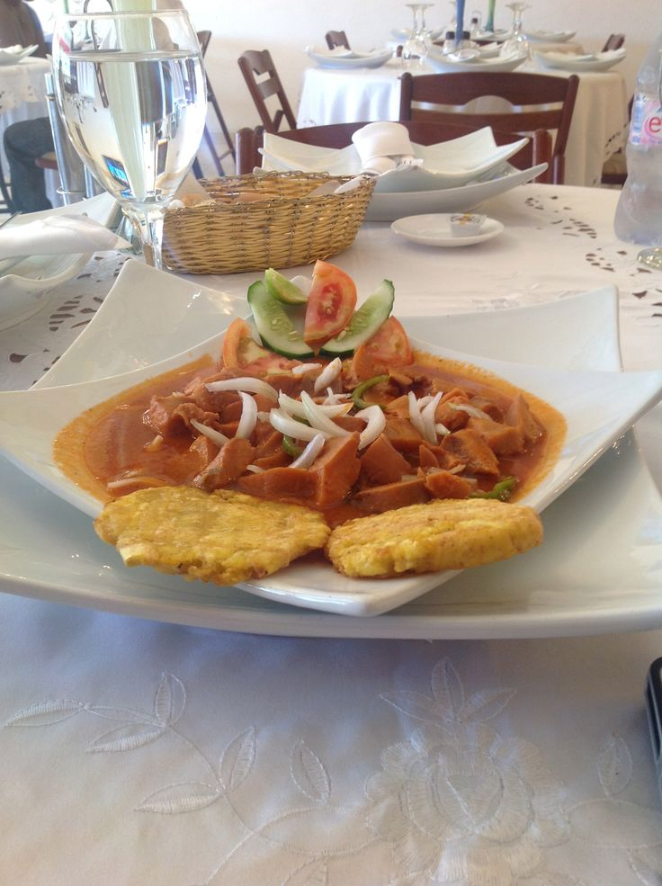 Lambi (conch) in sauce creole with fried plantains ...