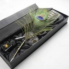 Description: Type: Dip pen Material: Natural peacock feather Color: Natural peacock feather's color Gift Box Size: 38 x 11.5 x 5 cm Bottled Ink: 25ml Color of Pen Stand: silver Package Included: 1 x P