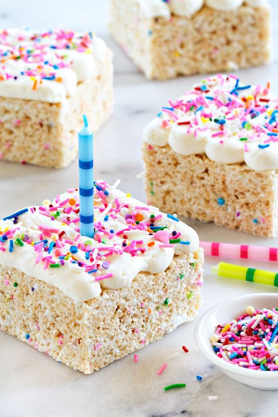 Birthday Marshmallow Cereal Treats are topped with buttercream frosting and loaded with sprinkles. from @bakingaddiction