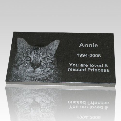 The Black Granite Pet Grave Marker (extra large) is made from premium jet black granite and include your favorite pet photograph along with a personalized message. The personalization is laser-engraved into the stone, creating a memorial that will remain without any loss in resolution for virtually one hundred years or more. This flat marker will become an elegant tribute to your beloved friend.