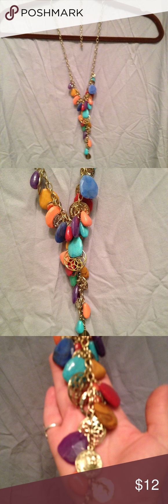 "RJ Graziano Colorful Long Necklace RJ  Graziano Goldtone necklace has colorful faux stones and goldtone charms. Length is 24"" with 4"" extension. Original Graziano  hang tag. Kept in jewelry box, Excellent condition. RJ Graziano Jewelry Necklaces"