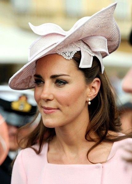 May 29, 2012 Catherine, joins the Royal Family at Buckingham Palace to attend a garden party during the Queen's Jubilee.