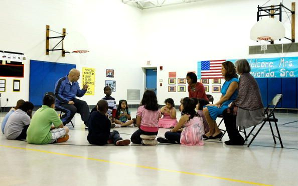 S first lady Michelle Obama and her Mexican counterpart Margarita Zavala listen to PE teacher Thomas Ryan during a physical education class as they...