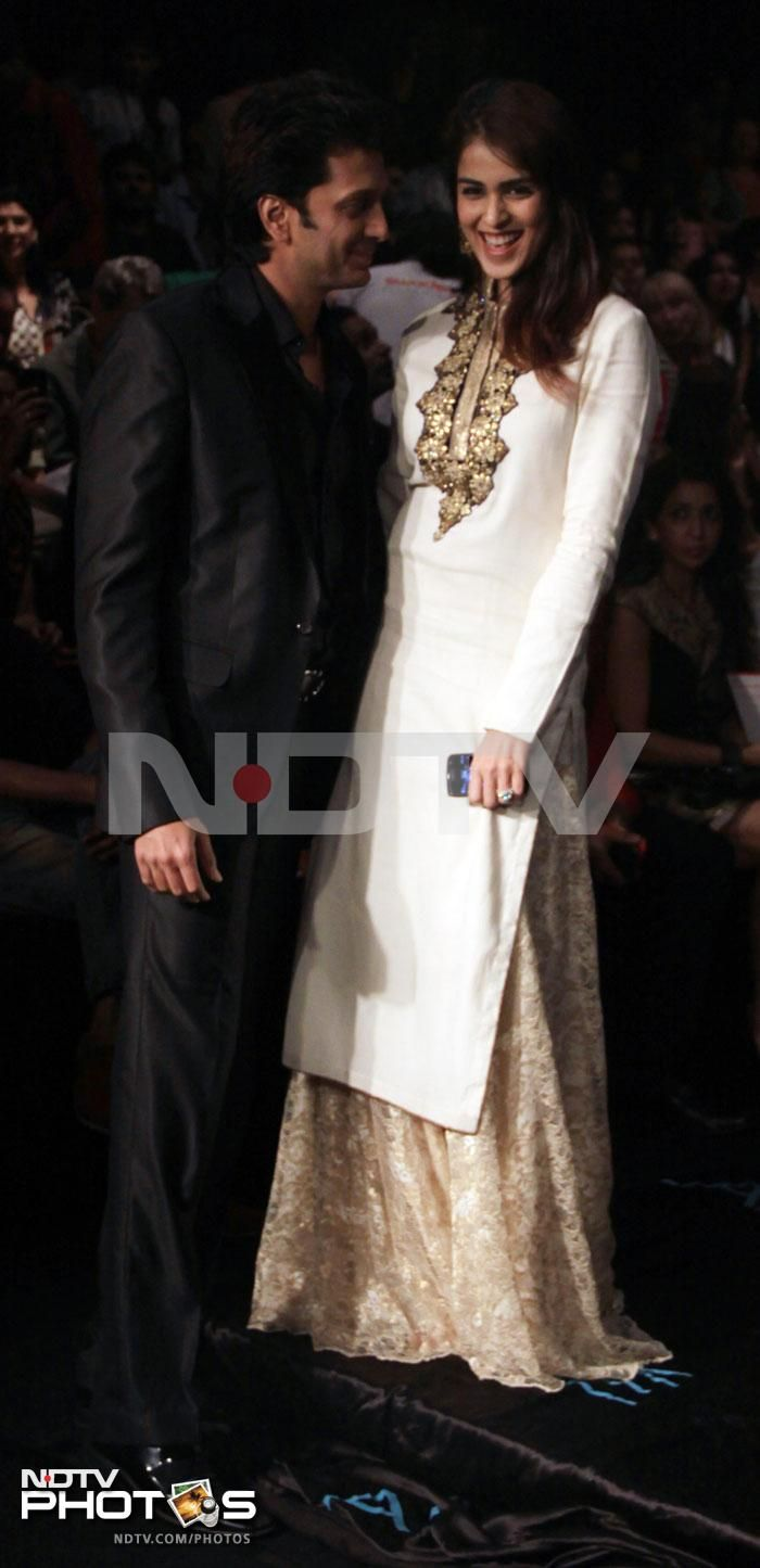For fashion with a heart: Riteish Deshmukh and Genelia didn't walk the ramp, but cheered for the designer from the audience.