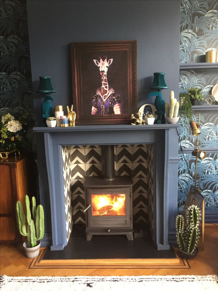 Newly fitted fire in our 1901 Arts & Crafts house. Custom made fireplace and bert & may tiles. Follow project @comedowntothewoods www.comedowntothewoods.com
