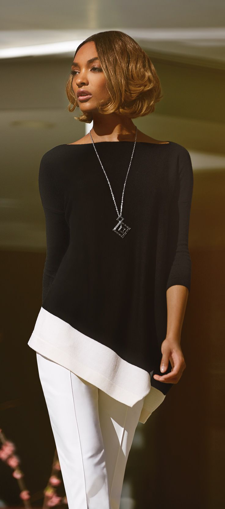 Jourdan Dunn in #StJohnKnits asymmetrical hemline sweater from the PreFall 2015 collection. | sjk.com