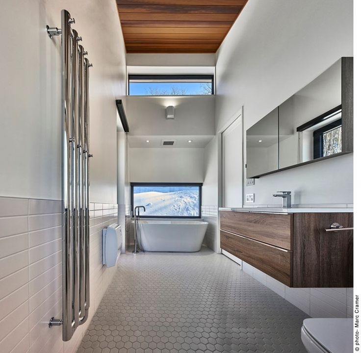 This master bathroom is bright and airy with its high ceilings and white walls.