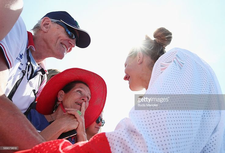 A member of silver medalists Great Britain celebrates after the medal ceremony for the Women's Eight on Day 8 of the Rio 2016 Olympic Games at the Lagoa Stadium on August 13, 2016 in Rio de Janeiro, Brazil.