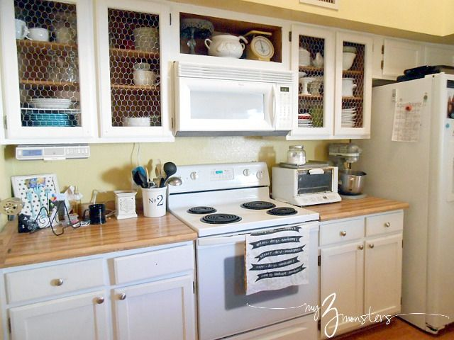 Kitchen Cabinet Facelift {Part 1} -- replacing inset panels with chicken wire for a farmhouse style vibe at {my3monsters.com} #diy #kitchen #cabinets