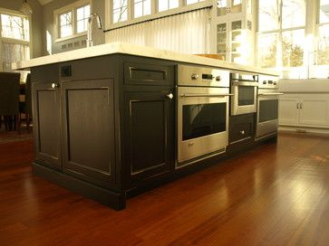 Large working center island with double wall ovens and drawer microwave traditional-kitchen