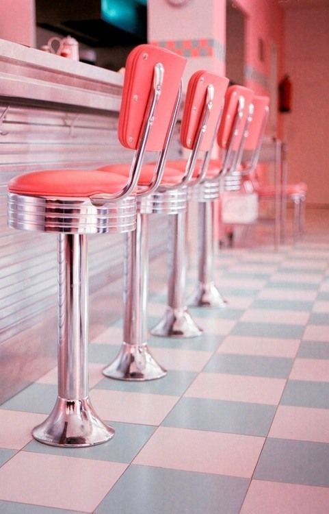 Your diner style kitchen doesn't have to stick to blacks and reds. Why not inject some colour with a rosy pink and pale teal?