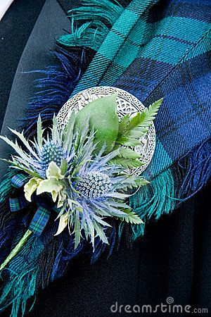 Scottish Wedding Button.    The thistle looks great with a fly plaid and brooch. This is a great formal look for a Scottish Wedding and sets the groom apart from the grooms-men. ~Rach (buyakilt.com)