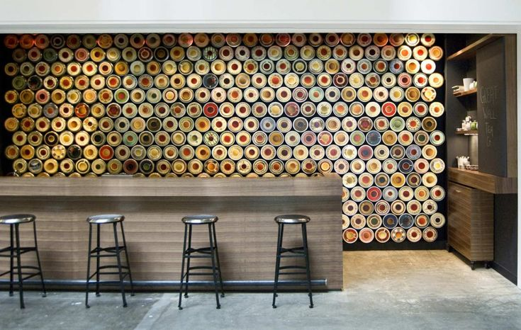 so fun for a retail concept - love it even more as an idea executed in an upbeat, residential kitchen - the design's patterned w/cups-n-saucers (here, adorning the wall of a tea shop)