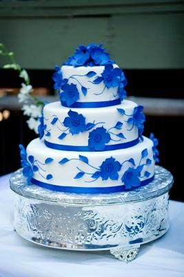 White Wedding Cake With Blue Flowers Its A Little Too Busy For Me But