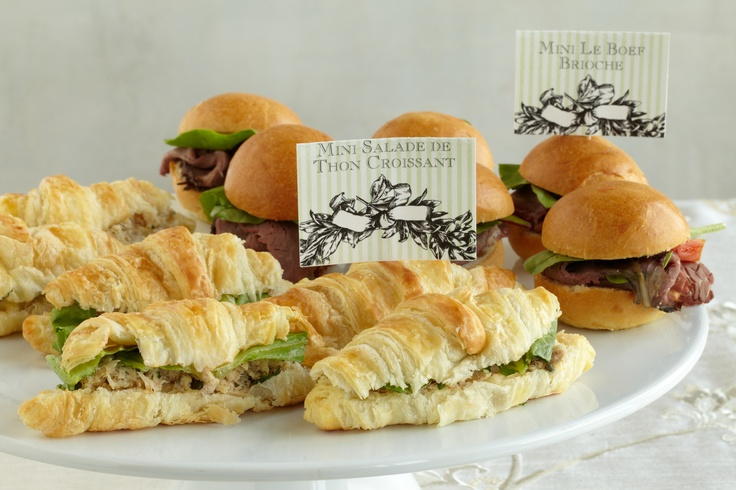 Finger Foods. Place French-inspired mini croissants with tuna fish salad and beef brioche sandwiches on simple white plates for your baby shower guests.