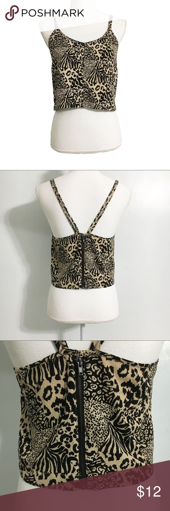 "Urban Outfitters Animal Print Crop Top Size S Urban Outfitters Animal Print Crop Top Size S  Animal print crop top from Silence + Noise (Urban Outfitters brand). Back zip closure. Used in excellent condition. Size S.   Fabric Content: - Body: 100% polyester  Measurements (not doubled, approximate and taken with garment laid flat): - Bust: 16.75"" - Hem width: 14.75"" - Total length: 12.75"" silence + noise Tops Crop Tops"
