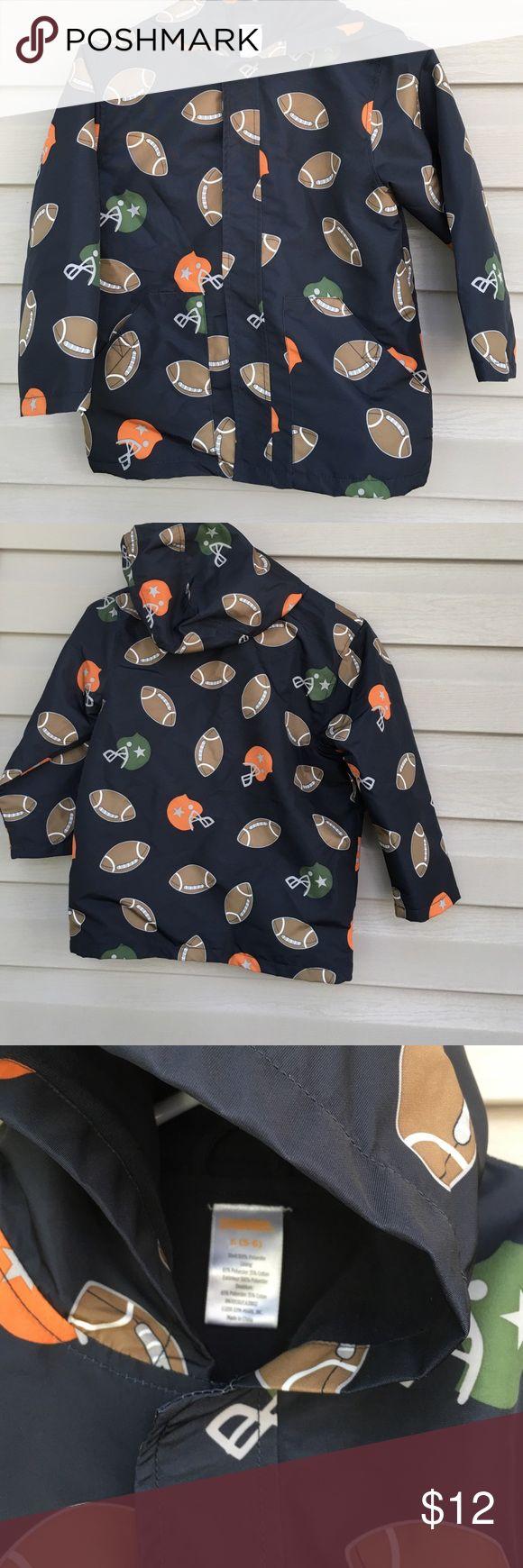 Gymboree boys raincoat Like new boys hooded raincoat lined with front pockets Velcro close no stains or holes. Football print Gymboree Jackets & Coats Raincoats