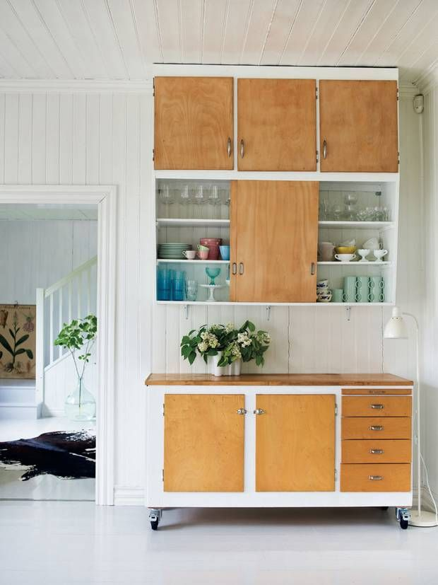 Use an old door on top of a dresser for storage. Where the door overhangs on the back, add legs for a counter top. Use for folding clothes or add a barstool and use the table for crafting -- or both.