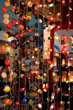 Funky light strands - string 'em up in a doorway! Looks neato + very hippie '60s; reminds me of old school doorway beads. Peace & light, baby.