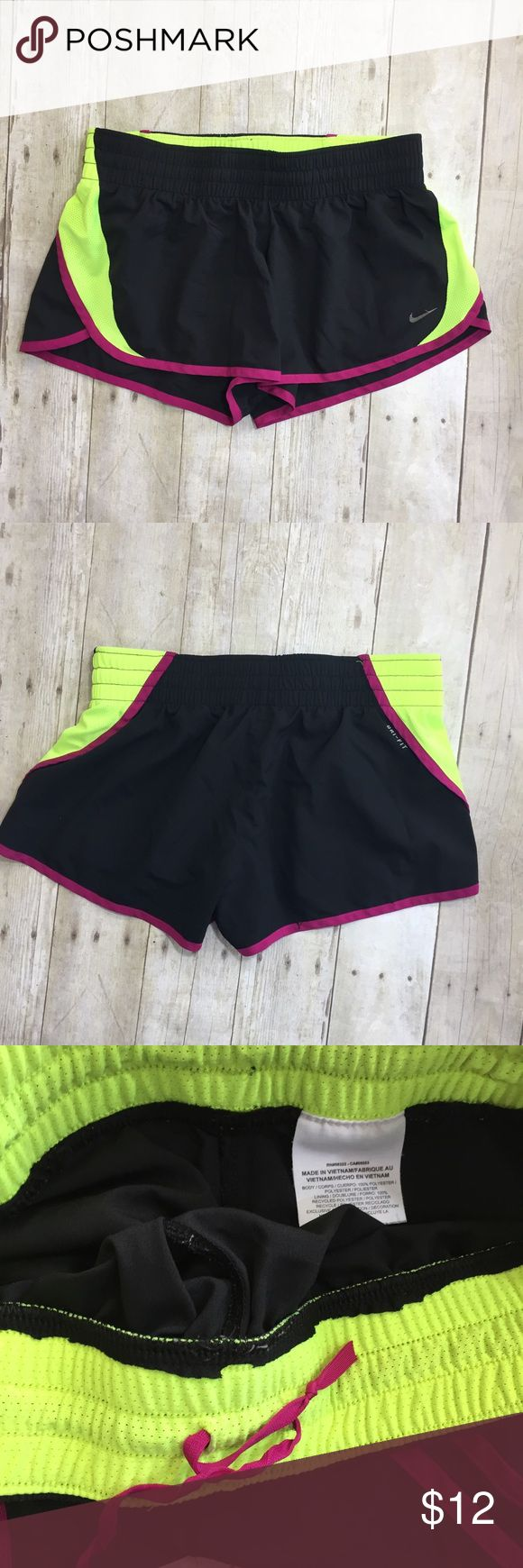 Woman's NIKE Dri-Fit Running Shorts Jogging S READ Woman's NIKE Dri-Fit Green/Pink/Black Running Shorts Jogging S READ. Unsure of size but runs a small. In good used condition. Nike logo is peeling a tad bit Nike Shorts