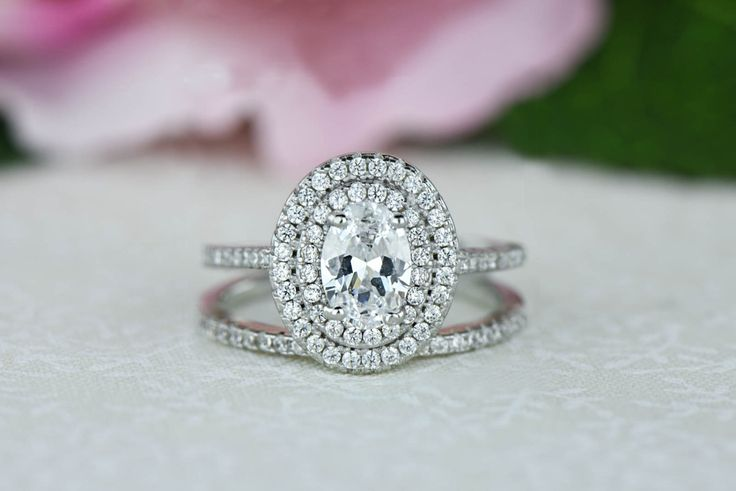1 ctw Oval Double Halo Ring, Engagement Ring, 3/4 Carat Center, Man Made Diamond Simulants, Wedding Set, Halo Bridal Set, Sterling Silver by TigerGemstones on Etsy https://www.etsy.com/listing/252219620/1-ctw-oval-double-halo-ring-engagement