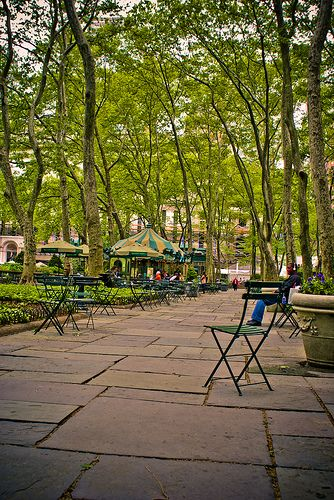 Bryant Park - New York City, New York. Located between Fifth and Sixth Avenues and between 40th and 42nd Streets in Midtown Manhattan, this is a gem of a park tucked behind the main building of the New York Public Library.