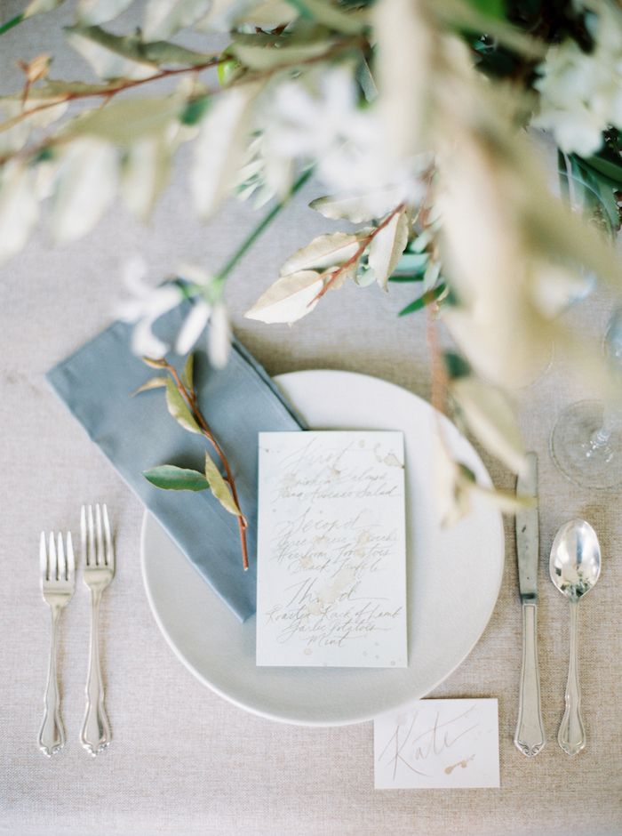 pretty calligraphy menu with green and white organic flowers