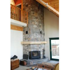 Wood Fireplace   An RSF Delta efficient wood fireplace finished by Friendly  Fires in a corner with stone.