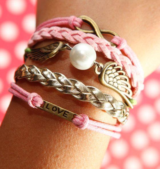 Karma Infinity Bracelet, Love Bracelet, Wing Bracelet, Pearl Bracelet, Pink Wax Cord Bracelet, Golden Braided Leather Bracelet. $5.12, via Etsy.