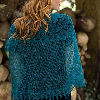'Irma' is a stunning half circle shawl using which is shaped by using Elizabeth Zimmerman's Pi formula and finished with a knitted-on lace edging.