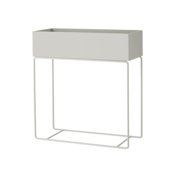 Elegant and timeless, this box on its delicate and thin legs in powder coated metal can be used for everything from plants to books or children's toys all aroun