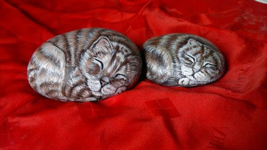sleeping cats painted on roks