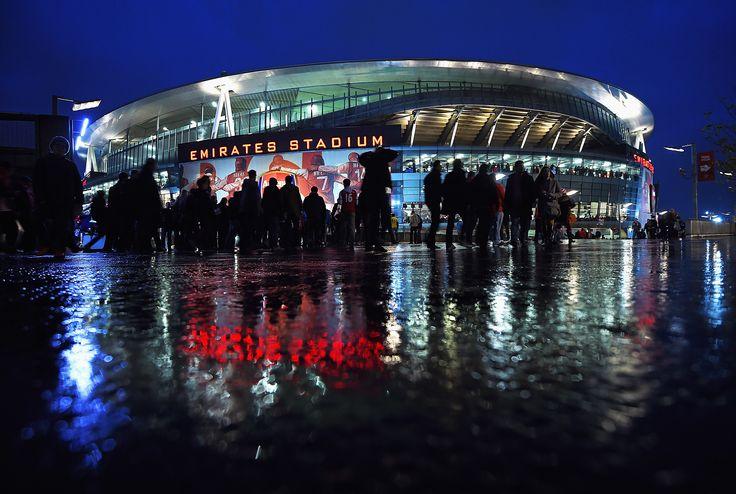 Emirates Stadium on a rainy night.