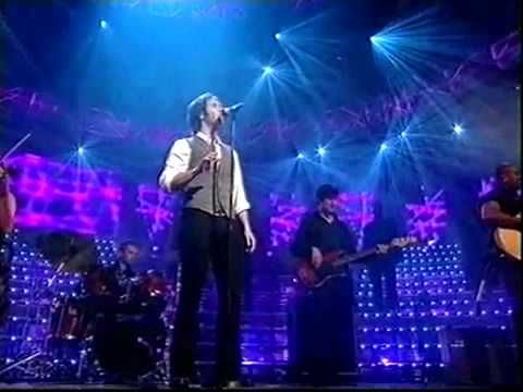 JOSH GROBAN ~ You Raise Me Up. His voice gives me goosebumps. Live it will bring tears to your eyes.