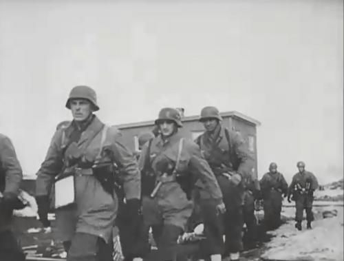 Fallschirmjägers in the mountains outside Narvik during the fighting in 1940. Notice the regular Army helmet some of them have been issued.