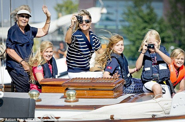 All together: Pictured left to right, Princess Beatrice, Princess Catharina-Amalia, Queen Maxima, Princess Alexia, Princess Mabel (holding camera) and Princess Ariane enjoy their day out on the canals in Amsterdam