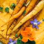 Get the recipe for this easy 6 ingredient roasted carrot and white bean dip from Vegetarian Heartland by Shelley Westerhausen! Savory, hearty, vegan.