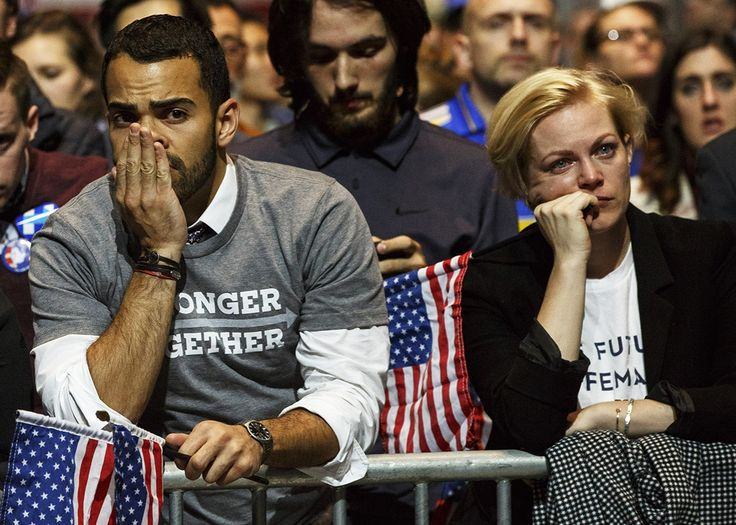 Supporters of U.S. Democratic presidential nominee Hillary Clinton watch as election projections are announced for the U.S. Presidential election on monitors at Democratic presidential nominee Hillary Clintons election night event at the Jacob Javits Center in New York City on Nov. 9, 2016.