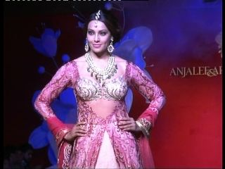 """Bollywood actor Bipasha Basu and leading models including Indrani Das Gupta sizzles on the ramp showing the collection of famous dress designer duo Anjalee and Arjun Kapoor. The event with the tag name """"Jamawar Aria Couture Collection 2013"""" was organized on Monday at Eros Hotel, New Delhi in which Bipasha was the showstopper."""