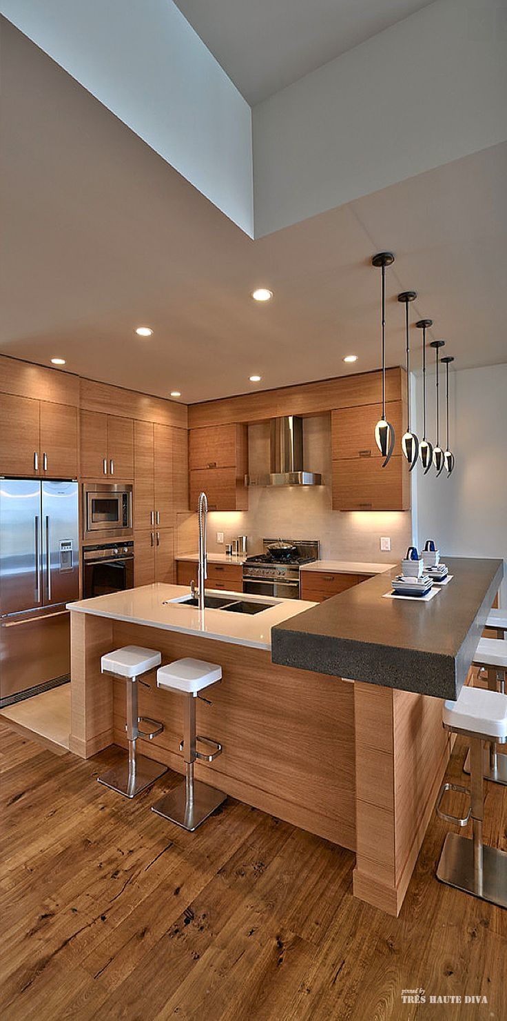 Unique Home Architecture .....wonderful kitchen...like the double bar seating