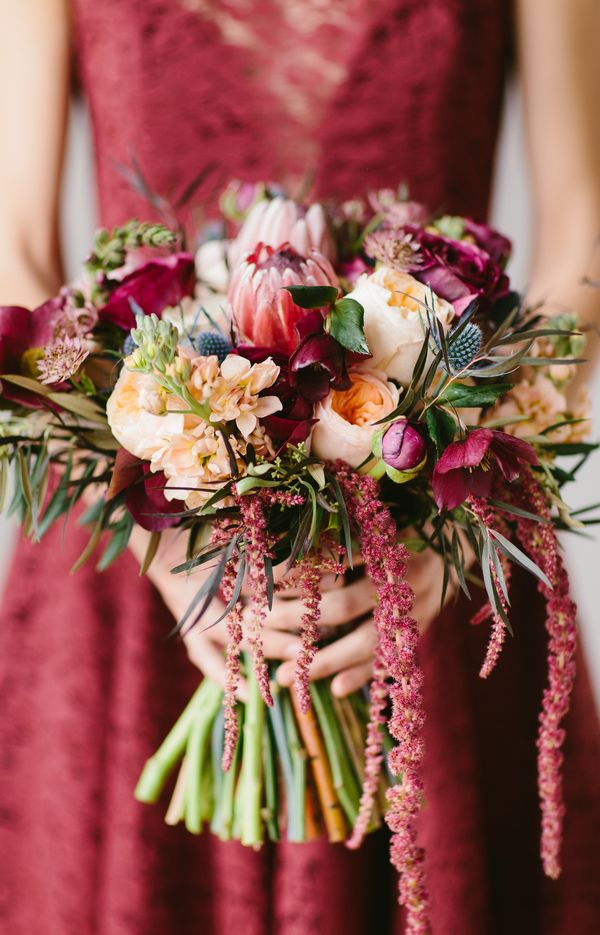 Gorgeous #Marsala Wedding Bouquet with protea, ranunculus, blue thistle and lotus pods / by Wallflower Designs / photo by Maggie Fortson Photography
