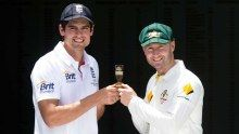 Alastair Cook and Michael Clarke pose with the Ashes Urn ahead of the first Test.