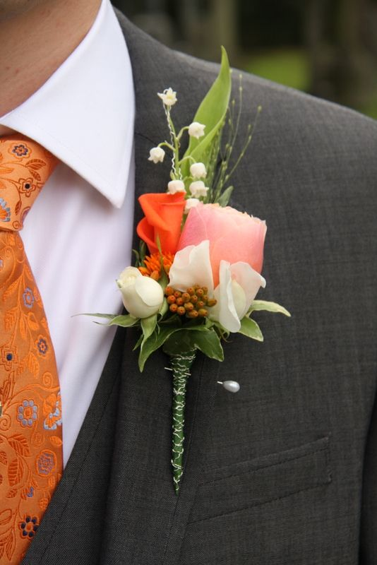 Bride Groom complete with his seriously splendid Boutonniere, which complimented his tie quite magnificently