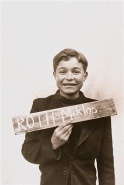 Miklos Roth, a displaced child who survived Auschwitz, tragically lost his mother and siblings except one upon arrival at Auschwitz in 1944, and his father died on a death March in April 1945 just before liberation. Miklos emigrated to the US, graduated college, served in the Marine Corps. He passed away in 2011, loved and remembered for his generosity and resilience.