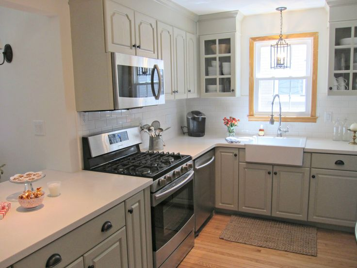 Corian Linen counters, light gray cabinets, white subway tiles