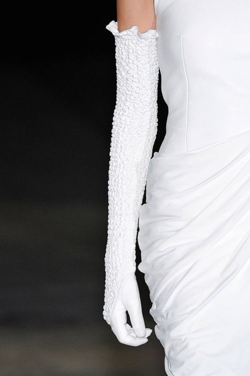 long above the elbow gloves add a touch of elegance and class!  Pristine white!