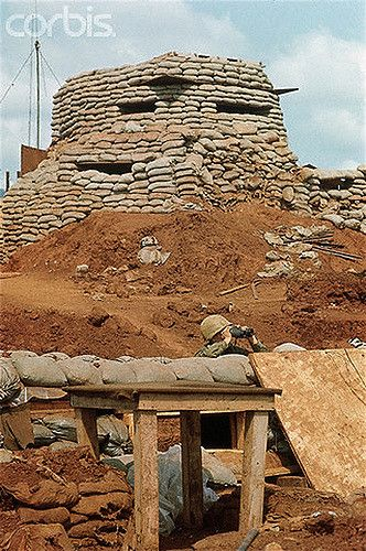 02 Jan 1968, Khe Sanh, South Vietnam --- 1/2/1968-Khe Sanh, South Vietnam- A soldier keeps watch outside the bunkers at Khe Sanh, one of the Marines' key bases in the northern portion of South Vietnam. --- Image by © Bettmann/CORBIS