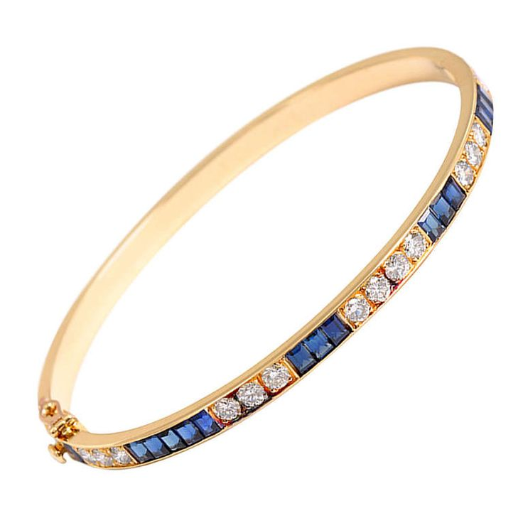 Van Cleef & Arpels Vintage Yellow Gold Sapphire and Diamond Bangle Bracelet | From a unique collection of vintage bangles at http://www.1stdibs.com/jewelry/bracelets/bangles/